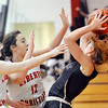 John P. Cleary |  The Herald Bulletin<br /> Daleville's Jenny Shellabarger, with ball, gets pressured by Liberty Christian's Kennedy Fillmore and Sarah Aikin after stealing the ball from Aikins.