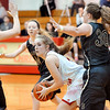 John P. Cleary |  The Herald Bulletin<br /> Liberty Christian's Paige Grant looks for someone to pass the ball to as she gets boxed in by Daleville defenders.