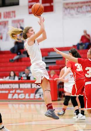 Don Knight |  The Herald Bulletin<br /> Frankton's Sydney Tucker pulls up for a jump shot as the Eagles hosted Mississinewa on senior night on Tuesday.