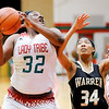 Don Knight | The Herald Bulletin<br /> Anderson's Kenigia Hamilton pulls down a rebound as the Lady Tribe hosted Warren Central on Tuesday.