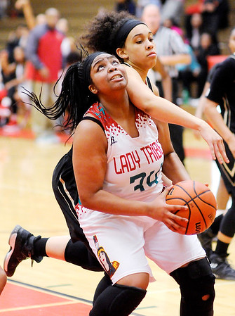 Don Knight | The Herald Bulletin<br /> Anderson's Tiana Ford looks for a putback after pulling down an offensive rebound as the Lady Tribe hosted Warren Central on Tuesday.
