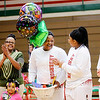 Don Knight | The Herald Bulletin<br /> Kenigia Hamilton, center, reacts to the announcement that she has surpassed 1,000 career points as Hamilton, Katie Martin and DeeDee Sutton were recognized on senior night as Anderson hosted Warren Central on Tuesday.