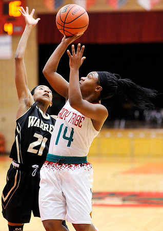 Don Knight | The Herald Bulletin<br /> Anderson's DeeDee Sutton shoots as she is guarded by Warren Central's K'ja Talley on Tuesday.