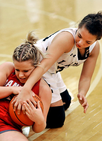 John P. Cleary |  The Herald Bulletin<br /> Frankton's Aleyah Rastetter and Lapel's Delany Peoples fight over a loose ball.
