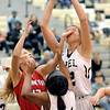 John P. Cleary |  The Herald Bulletin<br /> Lapel's Breanna Boles gets a hand in the face from Frankton's Sydney Tucker as Boles goes up for a shot after getting a rebound.