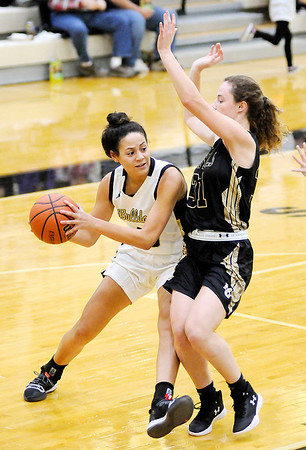 Don Knight | The Herald Bulletin<br /> Lapel's Makynlee Taylor looks to pass as she is guarded by Madison-Grant's Zoey Barnett on Tuesday.