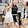 Don Knight | The Herald Bulletin<br /> Madison-Grant's Gracey Fox is double teamed by Lapel's Lily Daniels and Delany Peoples on Tuesday.