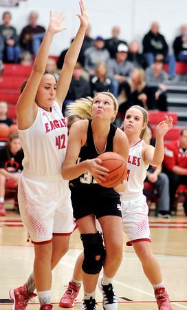 John P. Cleary |  The Herald Bulletin<br /> Lapel's Breanna Boles, with ball, gets double teamed by Frankton's Ryann Shively and Aleyah Rastetter as she tries to drive in the lane.