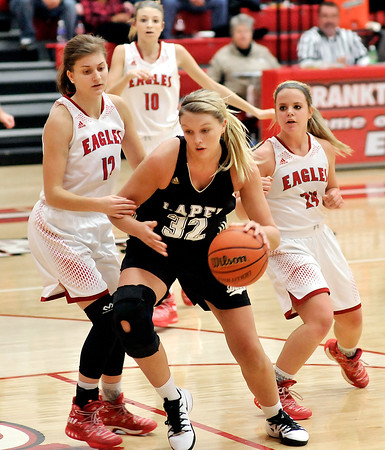 John P. Cleary |  The Herald Bulletin<br /> Lapel's Breanna Boles drives the lane between Frankton's Sydney Tucker and Aleyah Rastetter.
