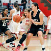John P. Cleary |  The Herald Bulletin<br /> Frankton's Sydney Tucker collides with Lapel's Sam Kern as she tries to drive up court.