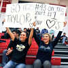 John P. Cleary |  The Herald Bulletin<br /> Lapel seniors Jada Hans, 18, and Kristina Turner, 17, support the Lady Bulldogs with their homemade signs during their basketball game against Frankton Monday evening.