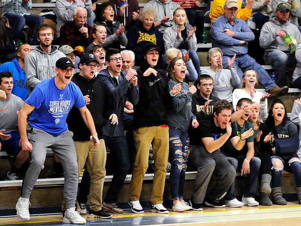 Don Knight |  The Herald Bulletin<br /> Shenandoah's student section reacts as the Raiders take the lead early in their game against Monroe Central on Tuesday.