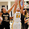 Don Knight |  The Herald Bulletin<br /> Shenandoah's Sami Delay grabs a defensive rebound as the Raiders hosted Monroe Central on Tuesday.