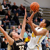 Don Knight |  The Herald Bulletin<br /> Shenandoah's Erikka Hill shoots over Monroe Central's Abigail McGrath on Tuesday.