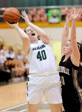 Don Knight |  The Herald Bulletin<br /> Pendleton Heights' Laikyn Conner shoots from the low post as she is guarded by Noblesville's Maddie Knight on Thursday.