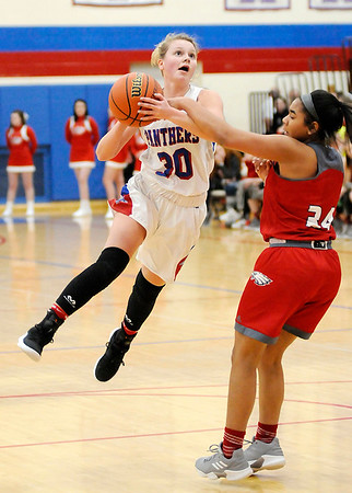 Don Knight | The Herald Bulletin<br /> Elwood's Claudia Leavell shoots as she is guarded by Frankton's Daija Kitchen on Friday.