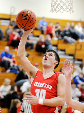 Don Knight | The Herald Bulletin<br /> Frankton's Kayden Key lays up a basket as the Eagles faced the Elwood Panthers on Friday.