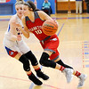 Don Knight | The Herald Bulletin<br /> Frankton's Addie Gardner drives as she is guarded by Elwood's Emily Booker on Friday.