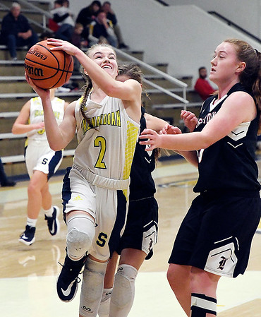 Shenandoah's Kathryn Perry drives to the basket for two of her 30 points she scored against Knightstown Thursday evening.