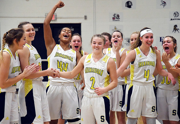 Kathryn Perry celebrates with her Lady Raider teammates after she scored her 1,000th career point as a Raider.