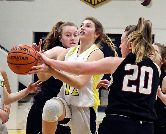 Shenandoah's Stormie Fitch splits the Knightstown defense as she drives the lane.