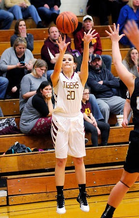 Don Knight   The Herald Bulletin<br /> Alexandria senior Logan King shoots from the perimeter as the Tigers hosted Madison-Grant on Thursday.