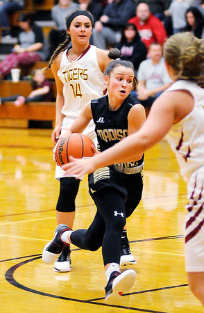 Don Knight | The Herald Bulletin<br /> Madison-Grant's Danyelle Hutson drives into the lane at Alexandria on Thursday.