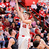 Don Knight |  The Herald Bulletin<br /> Frankton's Rylan Detling shoots as he is guarded by Elwood's Drew Leisure as the Eagles hosted the Panthers on Friday.
