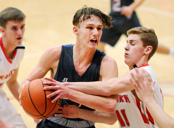 Don Knight    The Herald Bulletin<br /> Frankton's Brayton Cain forces a jump ball as he guards Elwood's Jack Bennett as the Eagles hosted the Panthers on Friday.
