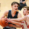 Don Knight |  The Herald Bulletin<br /> Frankton's Brayton Cain forces a jump ball as he guards Elwood's Jack Bennett as the Eagles hosted the Panthers on Friday.