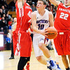 Don Knight | The Herald Bulletin<br /> Elwood's Seth Mireles splits Frankton's Rylan Detling and Maurice Knight on an underhanded layup at Elwood on Friday.