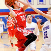 Don Knight | The Herald Bulletin<br /> Frankton's Landon Weins draws a foul from Elwood's Jack Bennett on a drive to the basket at Elwood on Friday.