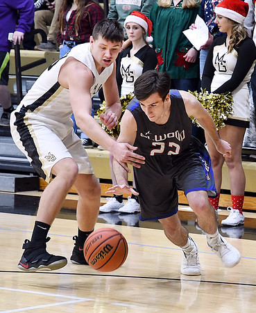 John P. Cleary | The Herald Bulletin<br /> Elwood vs Madison-Grant in Boys Basketball.