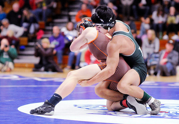 Don Knight   The Herald Bulletin<br /> Pendleton Heights' Ben Avey wrestles Chris Loy from Hamilton Heights for the 132 pound championship during the sectional at Elwood on Saturday.