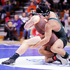 Don Knight | The Herald Bulletin<br /> Pendleton Heights' Ben Avey wrestles Chris Loy from Hamilton Heights for the 132 pound championship during the sectional at Elwood on Saturday.