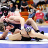 Don Knight | The Herald Bulletin<br /> Frankton's Dru Berkebile wrestles Guerin Catholic's JT Lazzara in the 160 pound championship during the sectional at Elwood on Saturday.