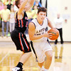 Don Knight | The Herald Bulletin<br /> Lapel's Will Jones drives as he is guarded by Wapahani's Garett Stanley on Friday.