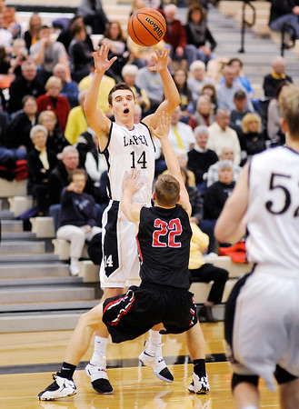 Don Knight | The Herald Bulletin<br /> Lapel's JonRoss Richardson passes the ball to Andrew Hunt as he is guarded by Wapahani's Brian Strout on Friday.
