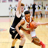 Don Knight |  The Herald Bulletin<br /> Anderson's Brandon Haralson draws a foul from Noblesville's Xavier Hines on a drive towards the lane on Saturday.