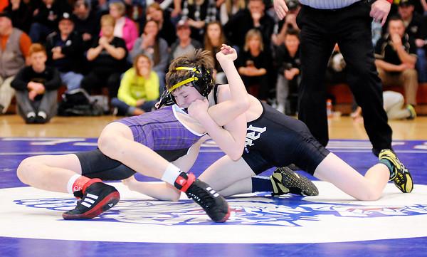 Don Knight | The Herald Bulletin<br /> Lapel's Harrison Hadley wrestles Guerin Catholic's Zach Sutton in the 106 pound championship.