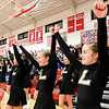 Don Knight |  The Herald Bulletin<br /> Lapel's cheerleaders hold their arms in the air as Bree Boles shoots a free throw as rivals Frankton and Lapel play each other in the first round of the Girls' Basketball Sectional at Frankton on Tuesday.