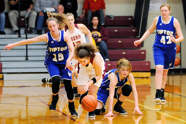 Don Knight |  The Herald Bulletin<br /> Alexandria's Blaine Kelly chases down a loose ball after knocking it away from Tipton's Lexi Altherr and Kelsey Mitchell in the sectional at Alexandria on Wednesday.