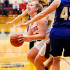 Don Knight |  The Herald Bulletin<br /> Alexandria's Mackenzie McCarty looks to shoot as she is guarded by Tipton's Rachel Majors in the sectional at Alexandria on Wednesday.