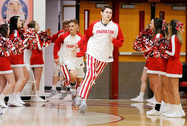 Don Knight | The Herald Bulletin<br /> The Frankton Eagles run on the court as they hosted the Hamilton Heights Huskies on Thursday.