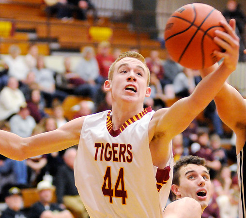 Don Knight | The Herald Bulletin<br /> Alexandria's Dane Hueston fights for a rebound as the Tigers hosted Lapel in the first round of the Madison County Basketball Tournament on Tuesday.