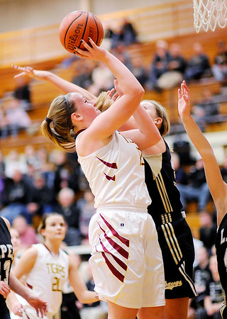Don Knight | The Herald Bulletin<br /> Alexandria's Mackenzie McCarty shoots as the Tigers hosted Lapel in the first round of the Madison County Basketball Tournament on Tuesday.