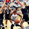 John P. Cleary |  The Herald Bulletin<br /> Anderson's Tyra Ford splits the Lapel defense as she drives the lane.