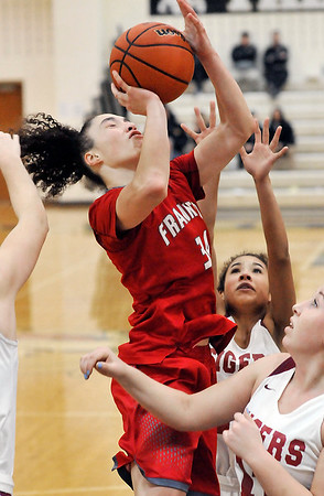 John P. Cleary |  The Herald Bulletin<br /> Frankton's Destyne Knight drives hard to the basket and gets fouled.