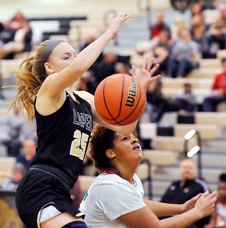 John P. Cleary |  The Herald Bulletin<br /> Lapel's Lexi Swanson looses control of the ball as Anderson's Lexi Fairer got a hand on it as Swanson drove to the basket.