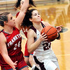 John P. Cleary |  The Herald Bulletin<br /> Alexandria's Blaine Kelly splits the Frankton defenders as she drives to the basket.
